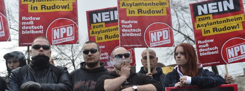 (FILES) This picture taken on November 24, 2012 shows supporters of German far-right party NPD (National Democratic Party of Germany) holding placards reading 'No place for asylum seekers in Rudow' during a demonstration in south east Berlin. Germany is to decide on December 6 whether to launch a new procedure aimimg at banning the NPD party. AFP PHOTO / ODD ANDERSEN